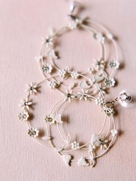 multi-hoop earrings with little white flowers for wedding