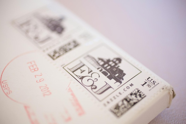 Couple's initials on stamp for wedding invite