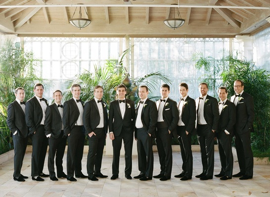 Groomsmen in tuxedos and black bow ties at Palm Beach wedding venue