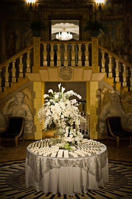 White floral arrangements on seating card table