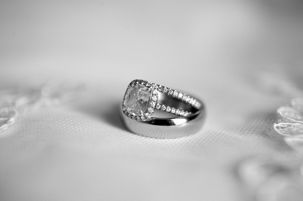 Black and white photo of engagement ring and wedding rings