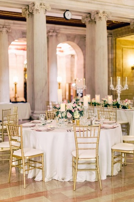 wedding reception columns white table gold chairs low centerpiece pillar candles crystal pink flower