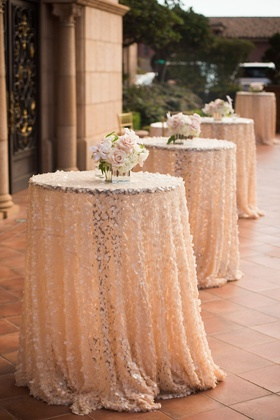 Sparkly sequin blush cocktail hour table cloths with orchid and rose centerpieces