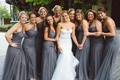 Bridesmaids in floor-length, one-shoulder gowns