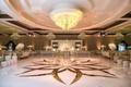 custom white dance floor with gold design, chandelier above