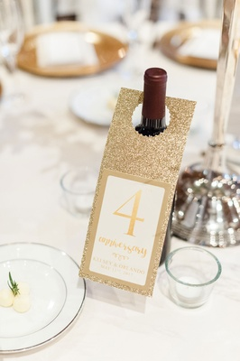 Wine bottle with gold door hanger table number for anniversary memory idea