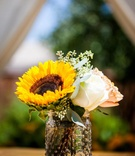Glass mason jar with sunflower and rose centerpice