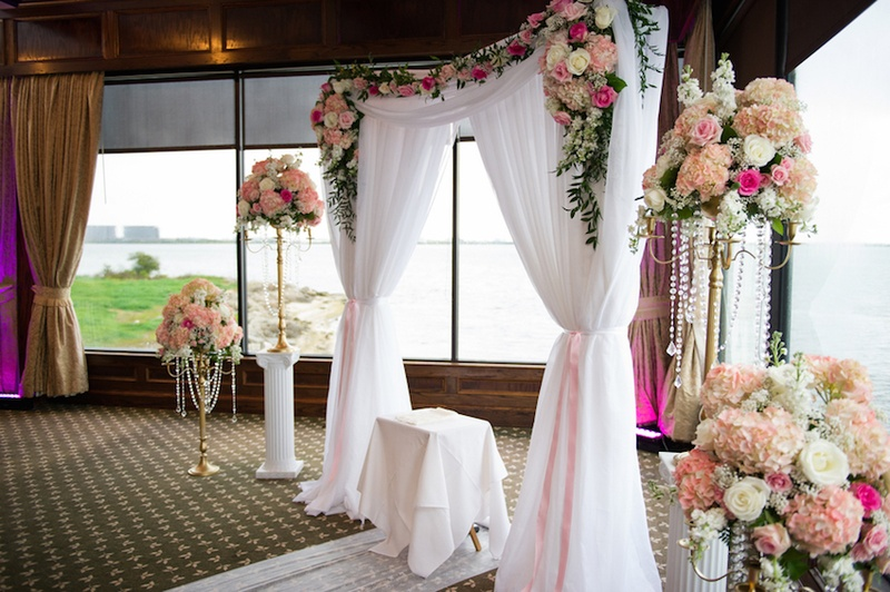 All White Indoor Wedding Ceremony Site: Floral-Embellished Indoor Altar