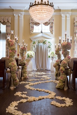 scroll of flower petals, candelabra surrounded by roses