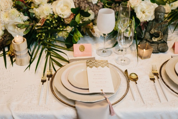 wedding place setting white wine glass goblet pink place card gold wax seal tassel on menu card gold