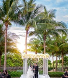 florida wedding, palm trees behind lucite chuppah with white flowers