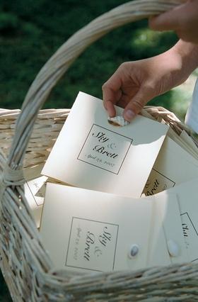 Sea shell wedding program in light color basket