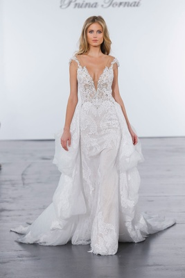 Pnina Tornai for Kleinfeld 2018 wedding dress sheer cap sleeve gown lace ruffle skirt in back