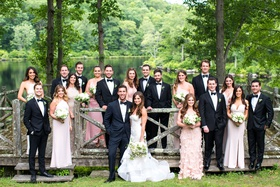 wedding party in front of lake cedar lakes estate new york venue summer camp feel mismatch dresses
