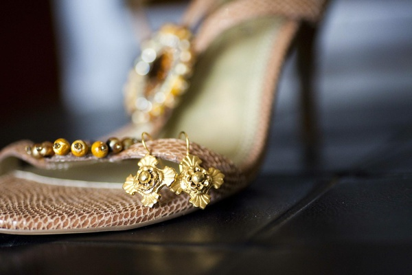 Golden bridal jewelry hooked on shoe strap