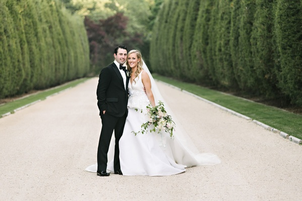 Wedding portrait couple bride and groom formal wedding in driveway of Oheka Castle in New York