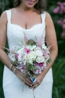 Small unstructured wedding bouquet with white rose, pink rose, and greenery