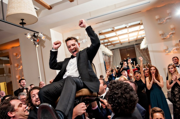 Traditional Jewish Hora Chair Dance At Indoor Wedding Reception