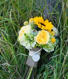 Green and yellow bridal bouquet wrapped in burlap