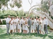 Bride and groom with grey groomsmen and white bridesmaids