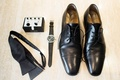 black loafers watch gem cufflinks silk tie