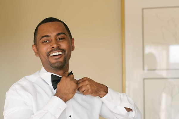 African American groom getting ready for wedding in groom's lounge