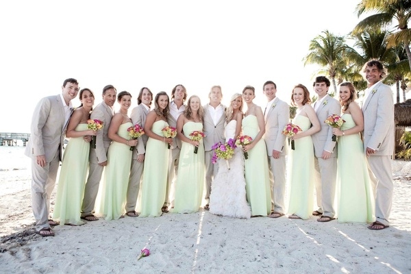 Bride and groom with casual groomsmen and bridesmaids