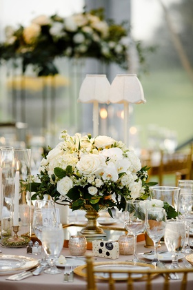 wedding reception table round table taper candles gold vase with white flowers greenery centerpiece