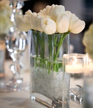 White tulips and floating candles