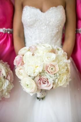 bride in strapless reem acra wedding dress white ivory ranunculus pink roses flowers