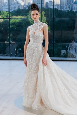 Embroidered strapless modified trumpet gown with opulent embroidered cathedral overskirt and cap sle