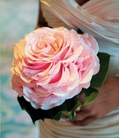 Bride's pink wedding bouquet designed to look like single rose