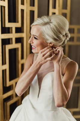 bride in isabelle armstrong wedding dress custom plunging neck illusion neckline blonde updo low