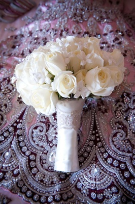 Pearl-dotted stephanotis and roses in white wrap