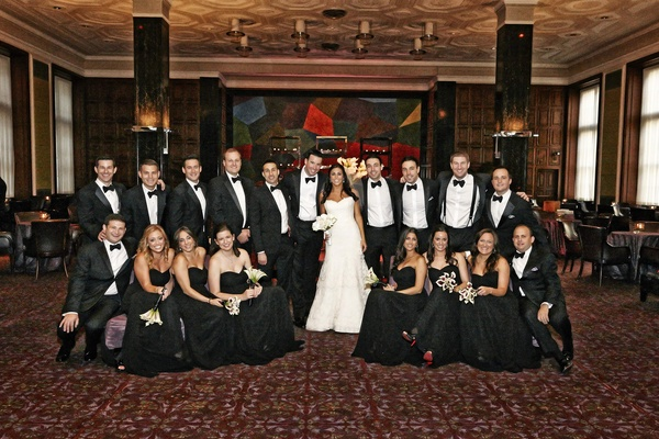 Black bridesmaid dresses and groomsmen in tuxedos