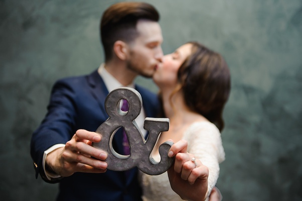 Cute bride and groom kissing portrait
