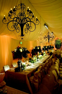 Crystal chandeliers above long tables
