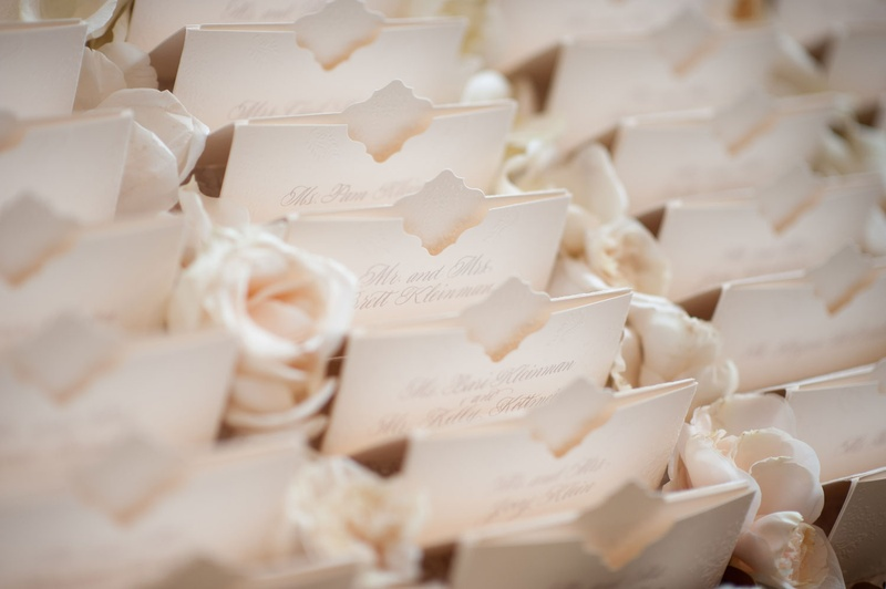 Ivory escort cards with unique design and pocket by Lehr and Black beverly hills wedding