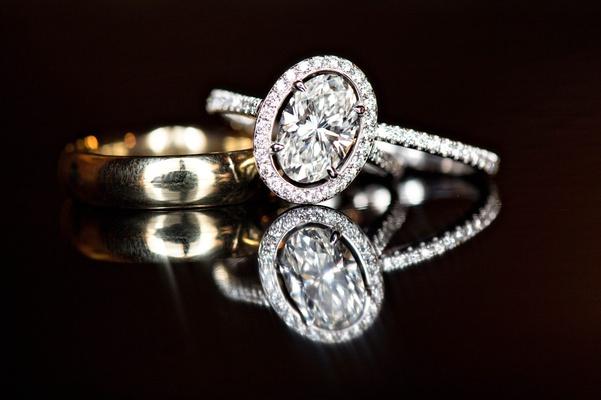 oval diamond halo engagement ring, diamond eternity band, plain yellow gold band