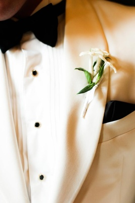 boutonniere of three stephanotis blossoms