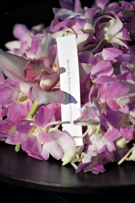 Bowl of orchids for guests to toss at couple
