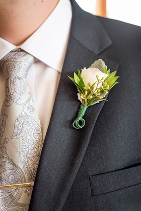 Lamb's ear, white rose, green leaf boutonniere and paisley tie