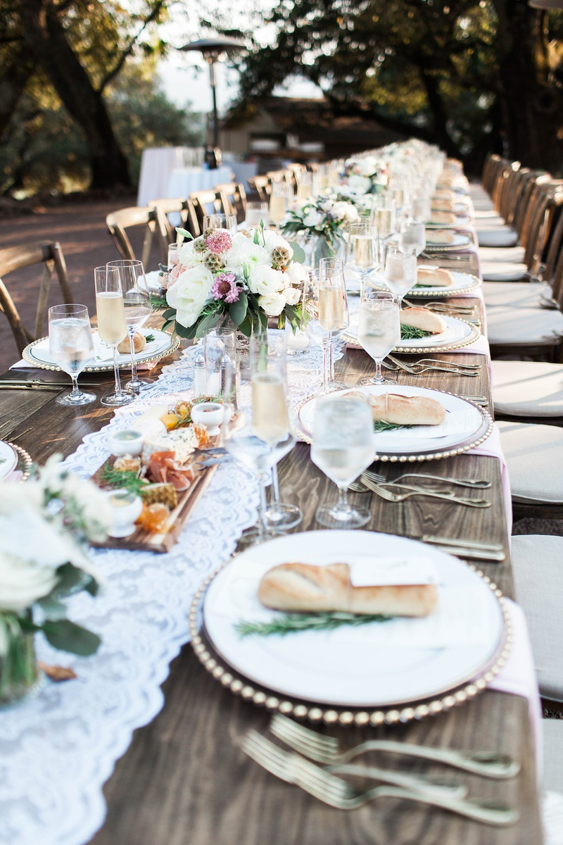 extended wooden tables lace runner florals simple rustic chic wedding reception winery bread