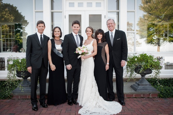Bride in Ines Di Santo dress with husband and parents