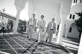 Black and white photo of men outside in Santorini