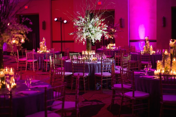 Indoor wedding reception with magenta lighting