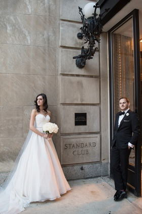 bride in essence of australia wedding dress, groom in bonobos tux, cool pose standard chicago