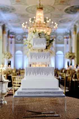 Modern wedding cake with square tiers and silver strands