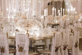 centerpieces with roses, hydrangeas, orchids, candles in reception