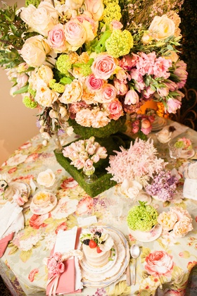 Bluebell Events styled shoot table with pink rose and moss centerpiece